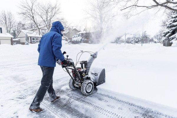 depositphotos_58516647-stock-photo-man-with-a-snow-blower